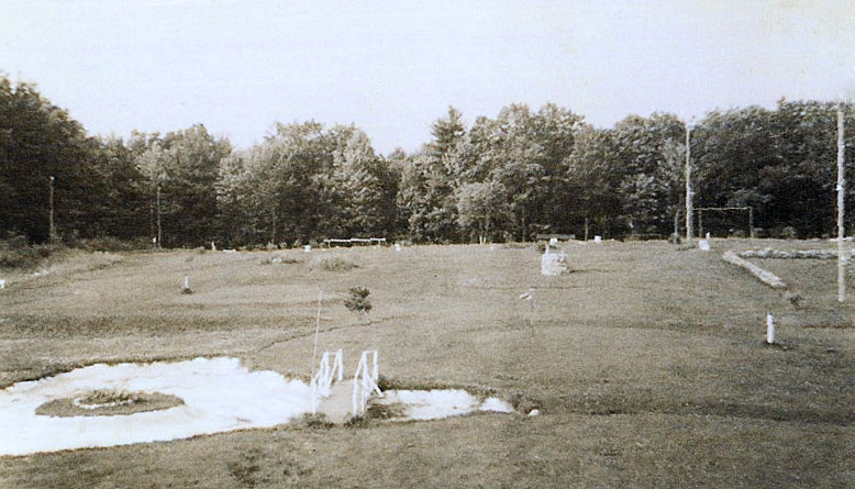 early photo of golf course with sand trap in foreground