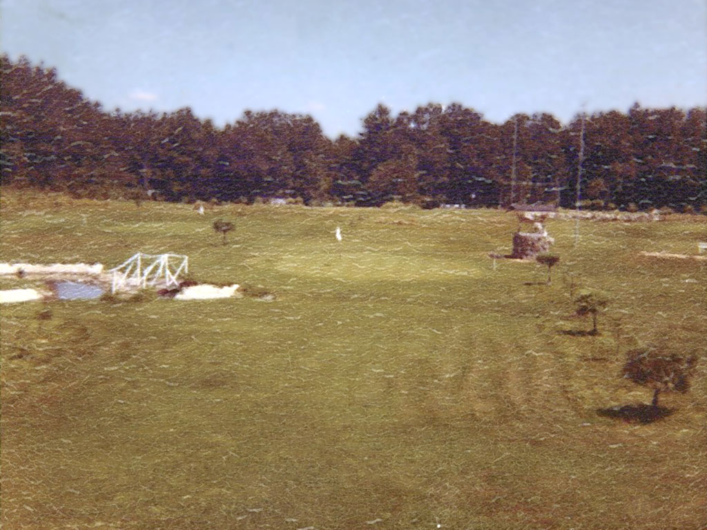 Early photo of golf course with trees just starting to grow